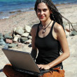 Girl with laptop on beach — Stok Fotoğraf #5448119