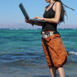 Girl with laptop on beach — Stok Fotoğraf #5448143