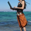 Girl with laptop on beach — Zdjęcie stockowe #5448143