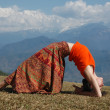 Stock Photo: Yoga in mountains.