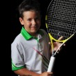 Stock Photo: Tennis boy isolated in black