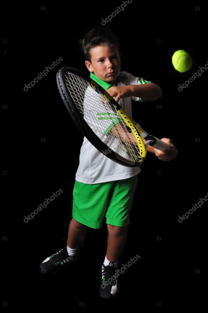 Tennis boy playing forehand isolated in black  Stock Photo #6472621