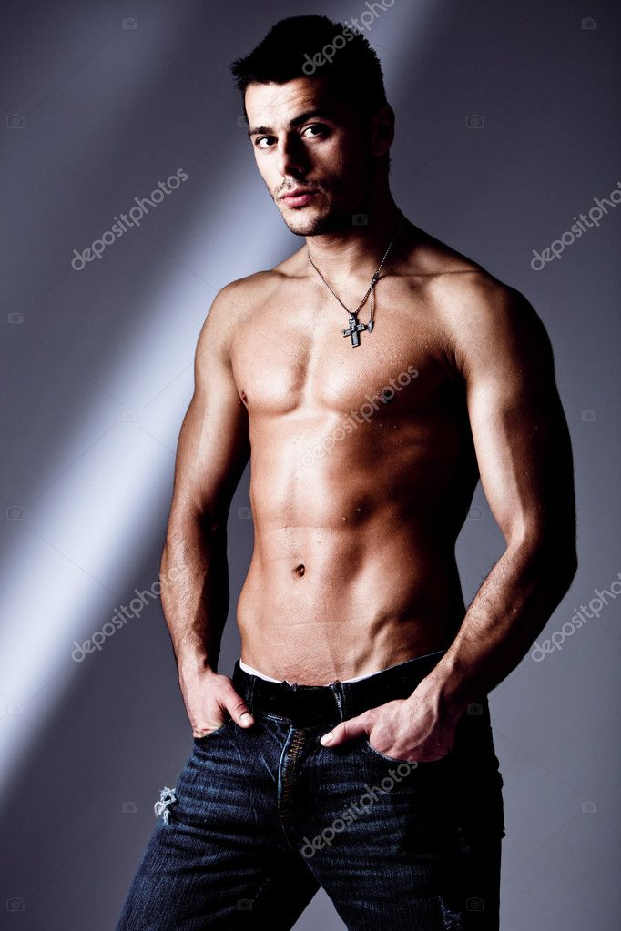 Handsome young shirtless man in jeans studio shot  Stock Photo #5471932