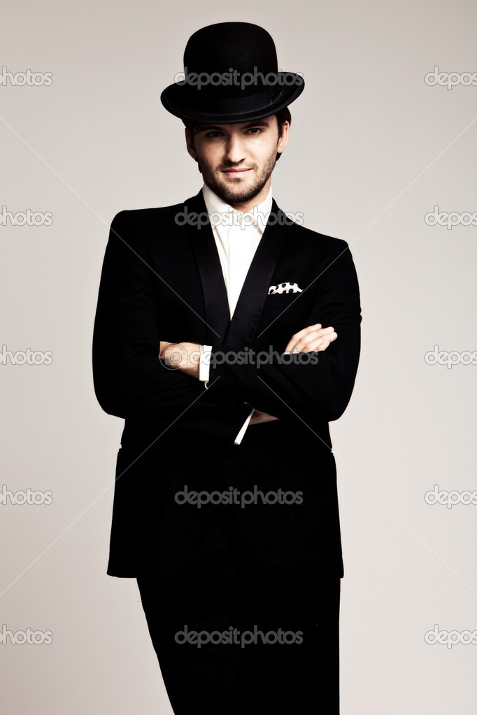 Elegant young man in black tuxedo and derby,studio shot — Stock Photo #6188910