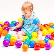 Baby girl play with balls — Stock Photo #6632519