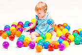 Baby girl play with balls — Stock Photo