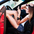 Sexy woman in sport car — Stock Photo