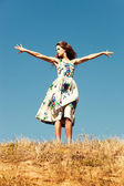 Woman on top of the hill, blue sky , summer day — Stock Photo