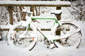 Bicycle under pack of snow — Stock Photo