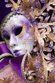 Purple decorative venetian mask — Stock Photo