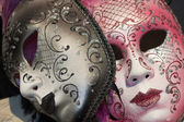 Brown and pink venetian carnival masks — Stock Photo