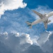 Airplane flying through clouds — Stock Photo #5689253
