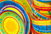 Colorful artisan plates and bowls — Stock Photo