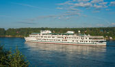 Passenger ship going down the river — Stock Photo