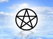 Pagan symbol on water — Stock Photo