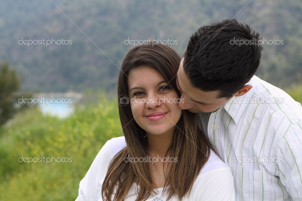 Close-up of man kissing and snuggling attractive woman — Stock Photo #5515025