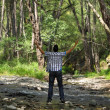Royalty-Free Stock Photo: Man in Forest with Arms Lifted Up