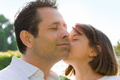 Little Girl Kissing Dad on Cheek — Stock Photo