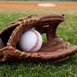 Baseball in Old Glove on Field — Stock Photo