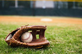 Old Baseball and Glove on Field — Stock Photo