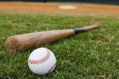 Baseball and Bat on Field — Stock Photo