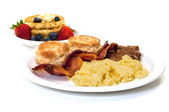 Breakfast with Eggs, Bacon , Sausage, Biscuits and Waffles — Stock Photo