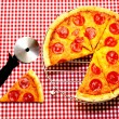 Whole Pepperoni Pizza and Cutter — Stock Photo #6365160