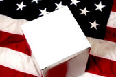 Blank White Box and American Flag Closeup — Stock Photo