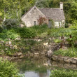 Typical Cotswolds garden in Bibury - Stock Photo