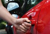 Women open shes car — Stock Photo