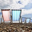 Deckchairs on Brighton beach — Stock Photo