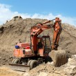 Excavator to dig below mountain — Stock Photo #6407277