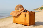 Yellow beautiful suitcase on a sea-shore — Stock Photo