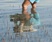 Reflection of man standing in a tropical lagoon — Stock Photo