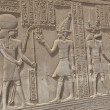 Hieroglyphic carvings on an Egyptian temple wall — Foto de Stock