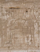 Egyptian hieroglyphics on a temple wall — Stock Photo