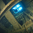 Stock Photo: Diver exploring inside shipwreck