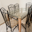 Stock Photo: Large dining table and chairs in house