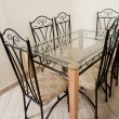 图库照片: Large dining table and chairs in house