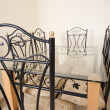 Large dining table and chairs in a house — Stok fotoğraf