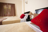 Twin beds in a bedroom — Stock Photo