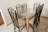Large dining table and chairs in a house — Stockfoto