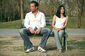 Man and woman sitting on a chair — Stock Photo