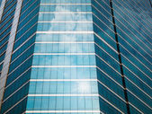 Glass of modern buildings and sky reflect — Stock Photo