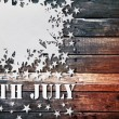 Foto Stock: White paper star fourth july on wood