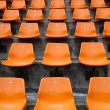 图库照片: Orange seats on stadium vertical