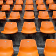Orange seats on the stadium vertical — Stock Photo