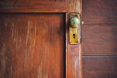 Door knob and keyhole made of brass — Stock Photo