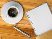 White cup of hot coffee and blank page note book — Stock Photo