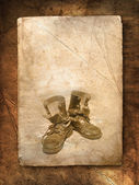 Old black top boot on paper — Stock Photo